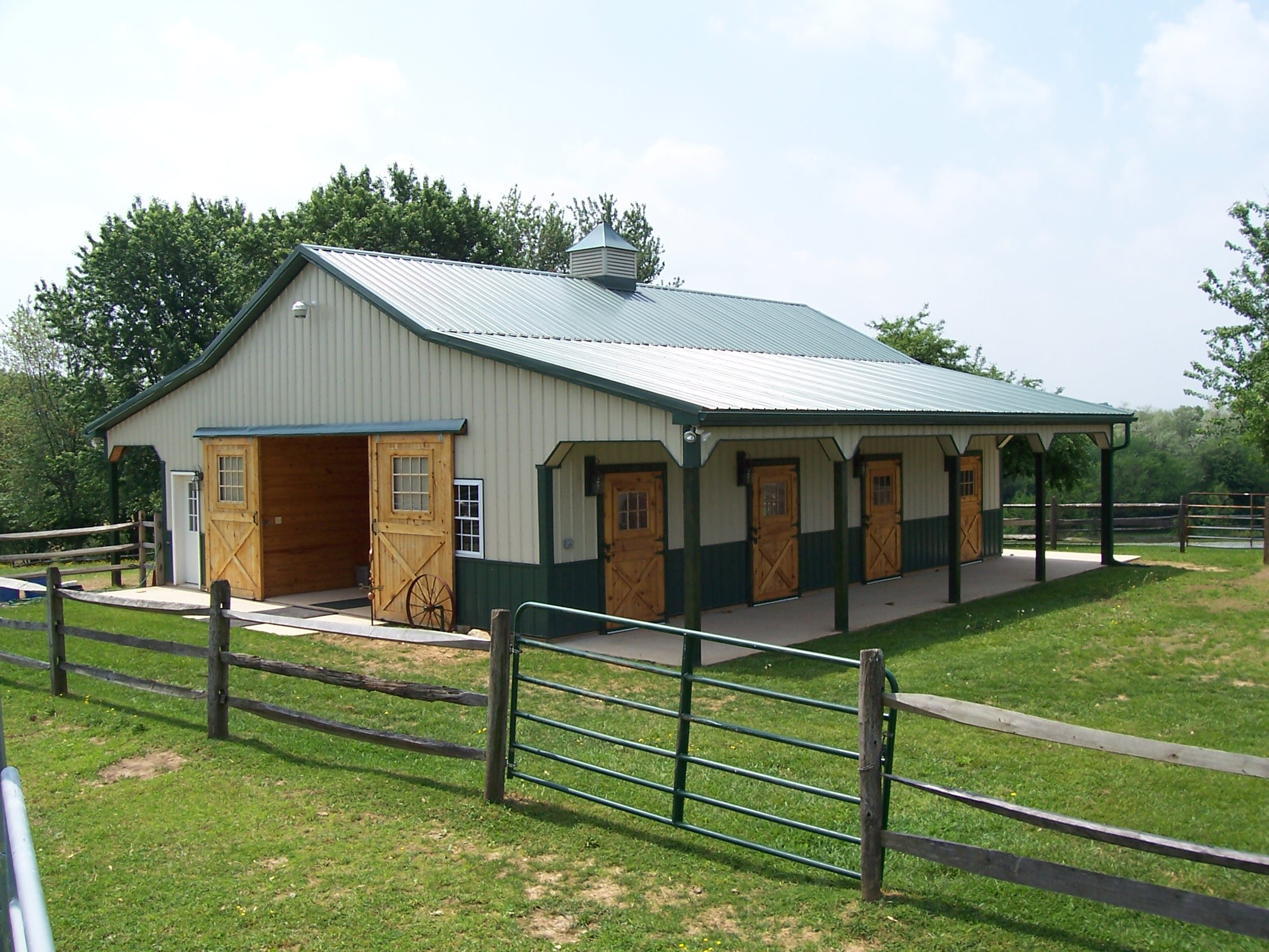 Building better steel horse barns metal prefab buildings for Metal barn pictures