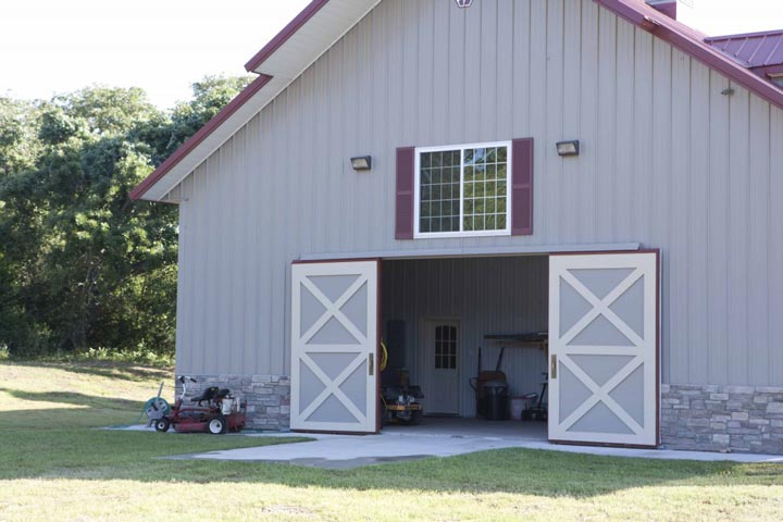 Metal Building Home With Garage, Porch And Barn
